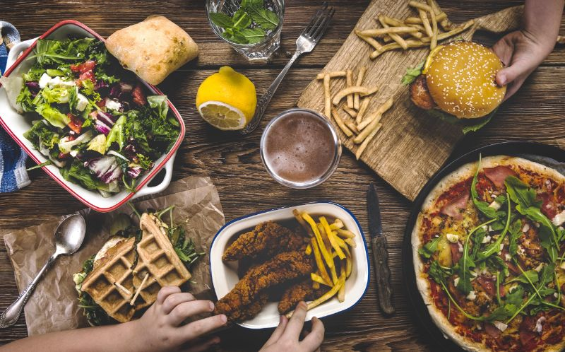 different kinds of foods on wooden table